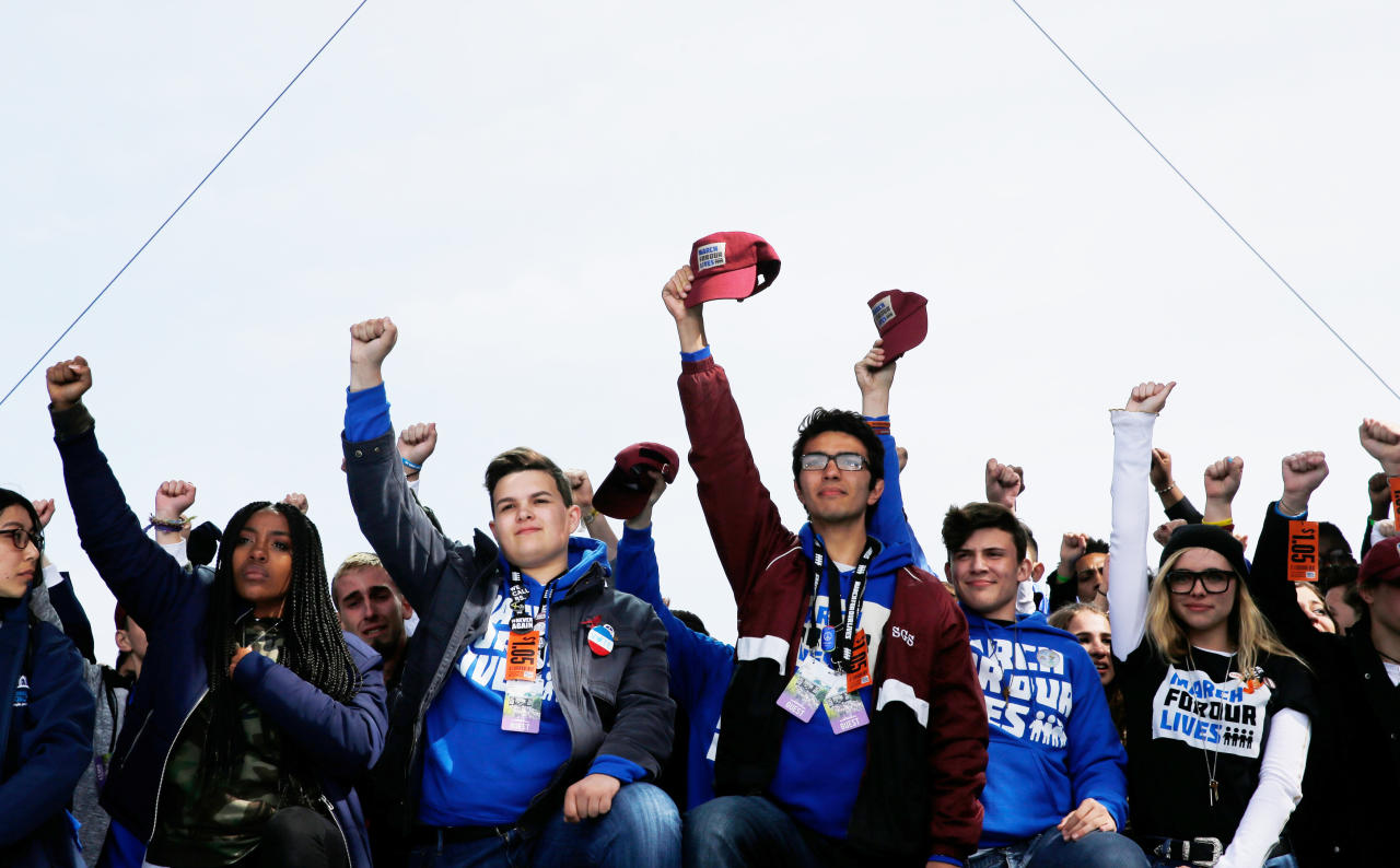 "<p>Students and school shooting survivors hold their fists and hats aloft in solidarity at the conclusion of the ""March for Our Lives"" event demanding gun control after recent school shootings at a rally in Washington, U.S., March 24, 2018. (Jonathan Ernst/Reuters) </p>"