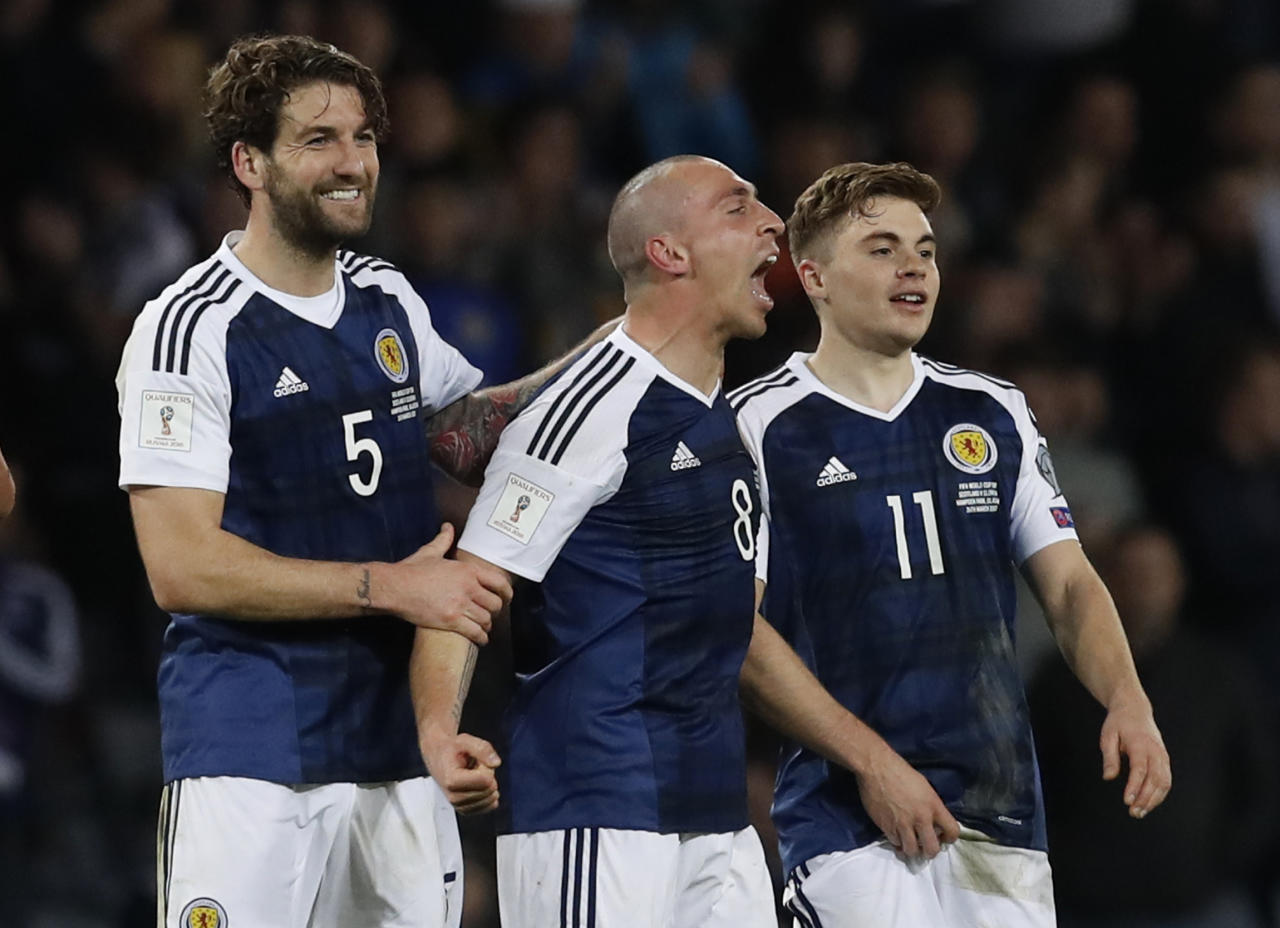 Britain Football Soccer - Scotland v Slovenia - 2018 World Cup Qualifying European Zone - Group F - Hampden Park, Glasgow, Scotland - 26/3/17 Scotland's Charlie Mulgrew, Scott Brown and James Forrest celebrate after the match Reuters / Russell Cheyne Livepic EDITORIAL USE ONLY.