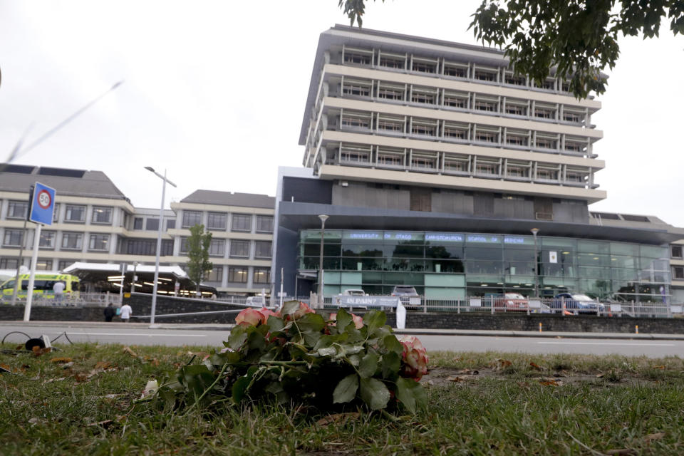 FILE - In this March 16, 2019, file photo, flowers are placed outside Christchurch Hospital in Christchurch, New Zealand. Health Minister Andrew Little said Wednesday, April 21, 2021, that New Zealand will overhaul its fragmented healthcare system to create a new national service similar to the one revered by many in Britain. (AP Photo/Mark Baker, File)