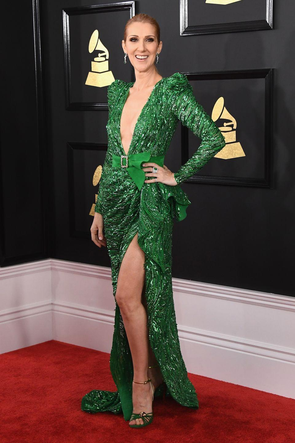 <p>The singer stunned in a plunging emerald gown featuring a thigh-high slit by Zuhair Murad at the Grammy Awards. </p>