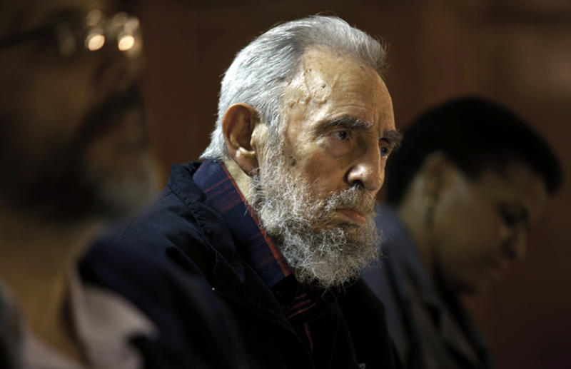 FILE - In this Feb. 10, 2012 file photo released by the state media website Cubadebate, Fidel Castro attends a meeting with intellectuals and writers at the International Book Fair in Havana, Cuba. Castro turns 86 on Monday, Aug. 13, 2012. (AP Photo/Cubadebate, Roberto Chile, File)