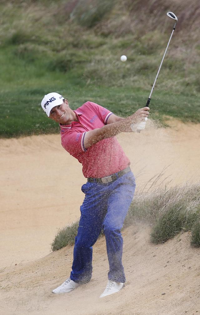 Early leader Luke Guthrie of the U.S. hits out of a bunker on 7th green during the second round of the BMW Masters golf tournament at the Lake Malaren Golf Club in Shanghai, China, Friday, Oct. 25, 2013. (AP Photo/Eugene Hoshiko)