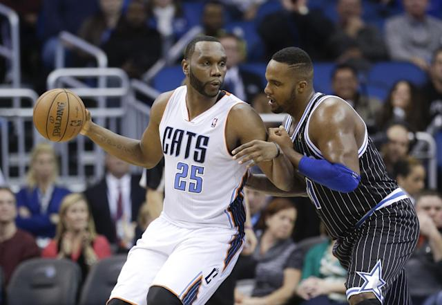 Charlotte Bobcats' Al Jefferson (25) makes a move to get to the basket around Orlando Magic's Glen Davis, right, during the second half of an NBA basketball game in Orlando, Fla., Friday, Jan. 17, 2014. Charlotte won 111-101. (AP Photo/John Raoux)