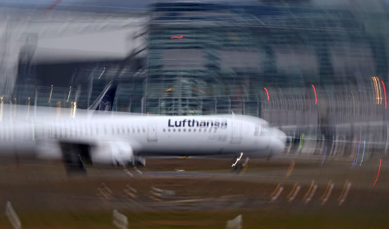 FILE PHOTO: An airplane of German Carrier Lufthansa lands at Frankfurt Airport