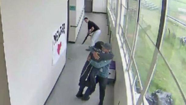 PHOTO: A still from a security video from Parkrose High School shows Keanon Lowe hugging a student who brought a shotgun to school. (KATU)