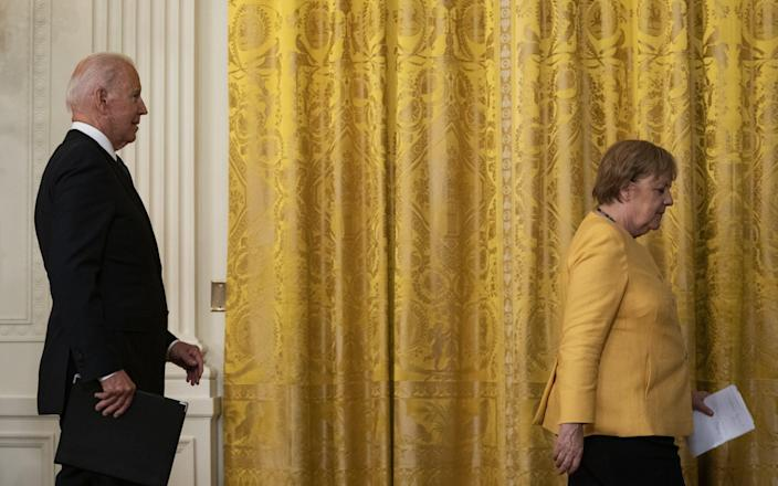 Joe Biden, right, and Angela Merkel, Germany's chancellor, depart a news conference in the East Room of the White House