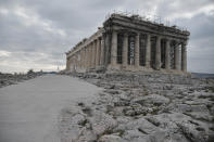 A view of the restorated path in front of the ancient Parthenon temple at the Acropolis hill, in Athens, Thursday, Dec. 3, 2020. Acropolis became fully accessible for people with disabilities after a restoration of the pathways and the inauguration of a new elevator. (Louisa Gouliamaki/Pool via AP)