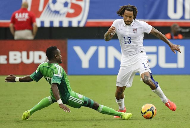 Nigeria's Ogenyi Onazi, left, tries to take the ball from United States's Jermaine Jones (13) during the second half of an international friendly soccer match in Jacksonville, Fla., Saturday, June 7, 2014. The United States won 2-1. (AP Photo/John Raoux)