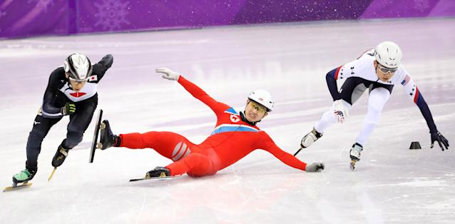 North Korean short-track speed skater Kwang Bom Jong slides on the ice. (EFE)