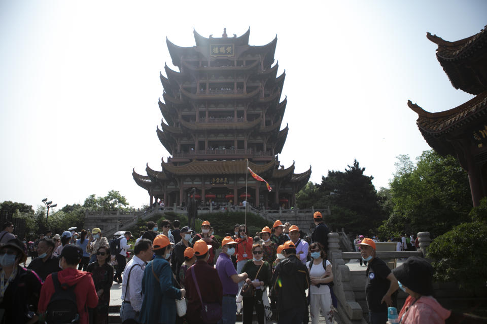 Tourists visit the Yellow Crane Tower on the first day of the May Day holiday on May 1 in Wuhan, Hubei Province of China. Source: VCG via Getty Images