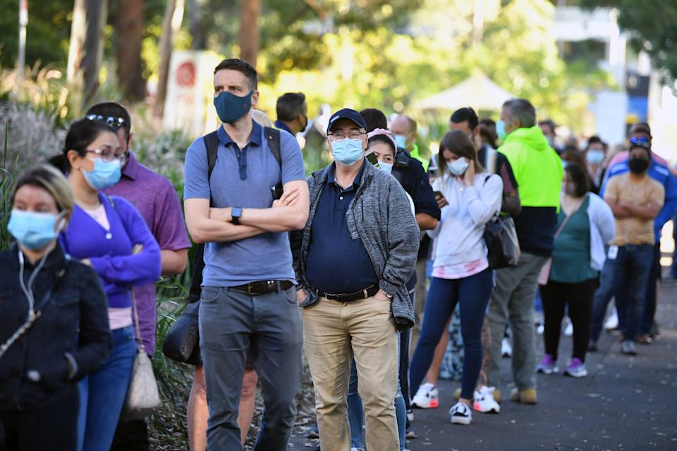 A queue forms outside at a mass Covid-19 vaccination hub in Sydney, Monday.