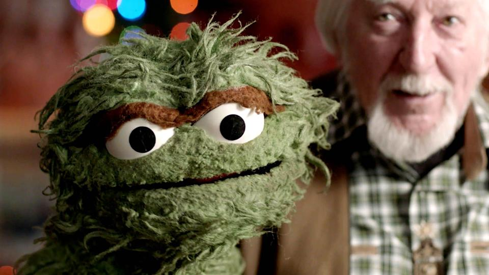 "Puppeteer Caroll Spinney poses with one of his iconic characters, Oscar the Grouch, in the documentary ""Street Gang: How We Got To Sesame Street."""