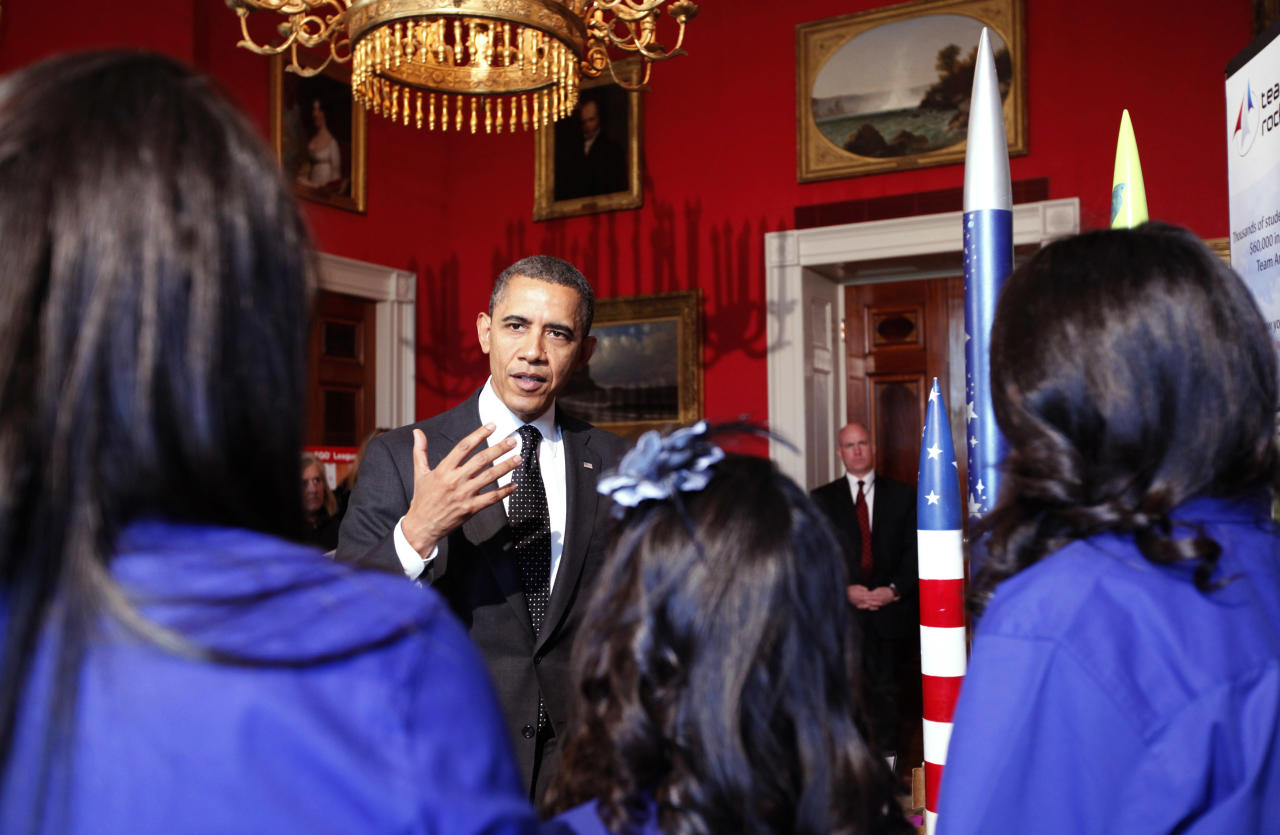 WASHINGTON, DC - FEBRUARY 07:  (AFP OUT) U.S. President Barack Obama speaks to members of Team America Rocketry Challenge (TARC), of Presidio, Texas, while touring student science fair projects on exhibit in the State Dining Room at the White House February 7, 2012 in Washington, DC. Obama hosted the second White House Science Fair celebrating the student winners of science, technology, engineering and math (STEM) competitions from across the country. (Photo by Molly Riley-Pool/Getty Images)