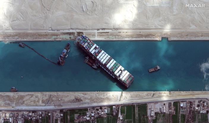 Dredging operations continue to dislodge the grounded container ship Ever Given in the Suez Canal on March 28, 2021.
