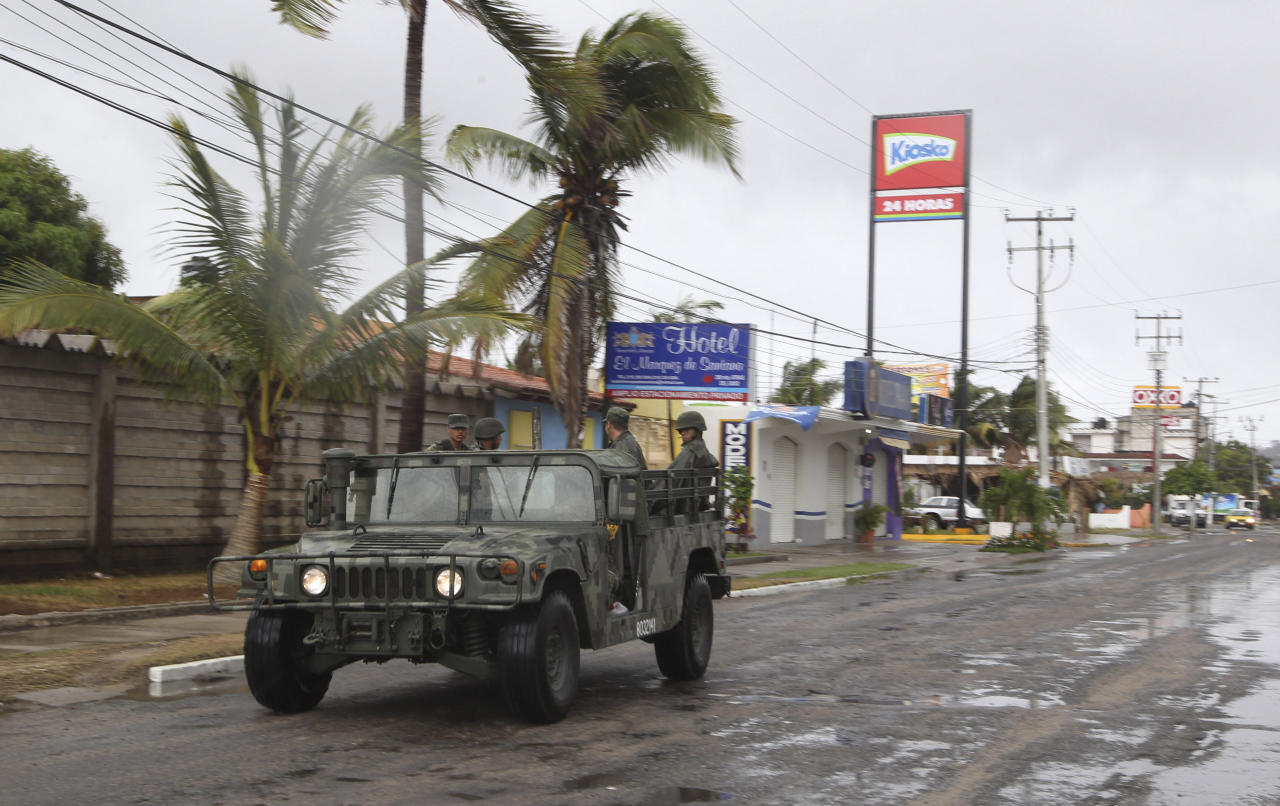 A navy vehicle drives along a street in the coastal town of Barra de Navidad as the community prepares for the arrival of Hurricane Bud along the Pacific coast of Mexico, Friday, May 25, 2012. Hurricane Bud lost a little of its sting early Friday, but remained a potent Category 2 storm as it headed toward a string of laid-back beach resorts and small mountain villages on Mexicoís Pacific coast south of Puerto Vallarta. (AP Photo/Bruno Gonzalez)