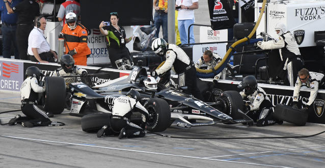 Ed Carpenter makes a pit stop during the IndyCar auto race Saturday, June 9, 2018, in Fort Worth, Texas. (AP Photo/Larry Papke)