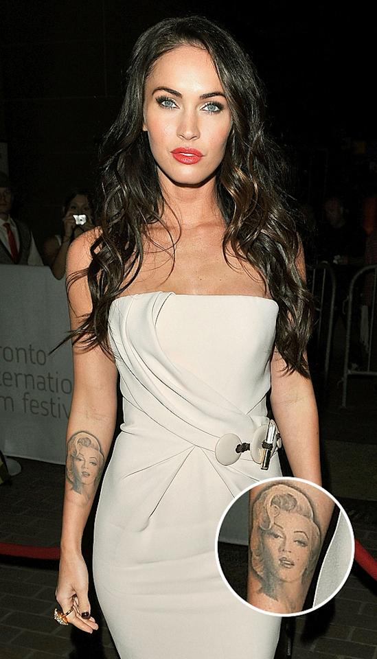 "Megan Fox loves Marilyn Monroe so much, she tattooed a portrait of the iconic movie star (at least, that's who Megan claims this is) on her forearm in 2009. But years later, the ""Transformer"" actress finally saw what we all did and began the painful process of having it lasered off. ""It hurts really bad,"" she told Jay Leno earlier this year of the removal. ""She doesn't look so good anymore."""