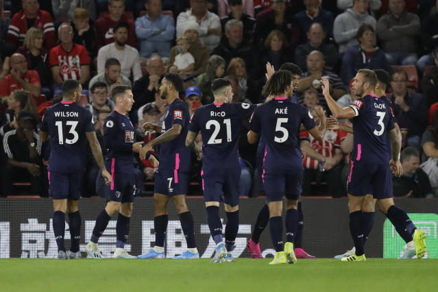 Bournemouth's Harry Wilson, second left, celebrates with teammates after scoring his side's opening goal during the English Premier League soccer match between Southampton and Bournemouth at St Mary's stadium in Southampton, England, Friday, Sept. 20, 2019. (AP Photo/Kirsty Wigglesworth)