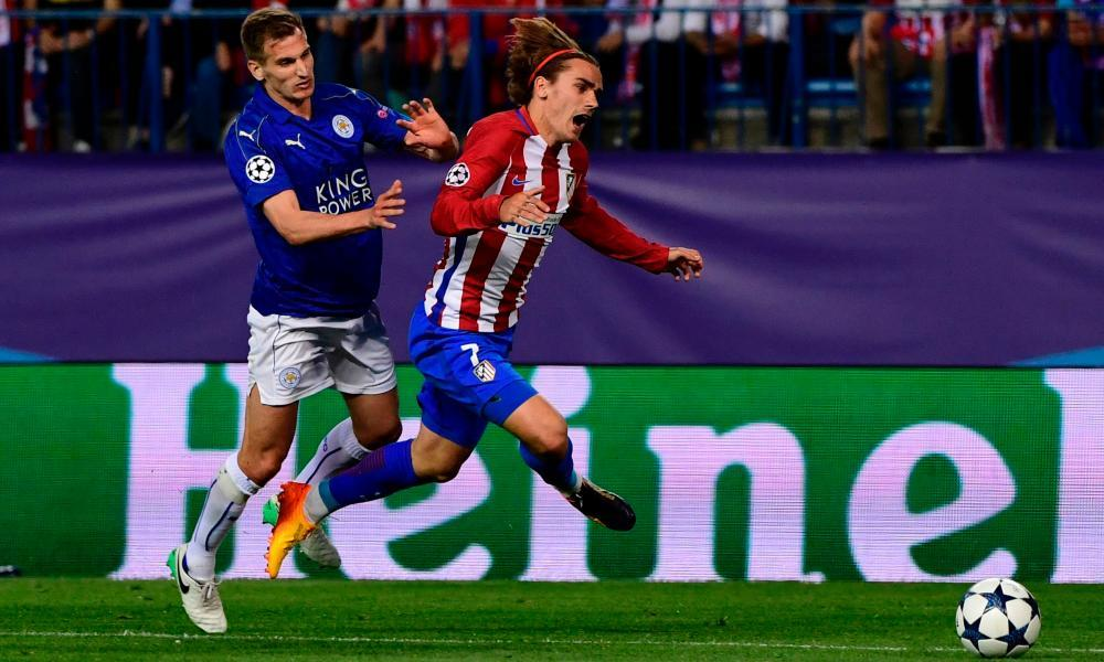 Leicester City's Marc Albrighton fouls Atlético Madrid's Antoine Griezmann outside the penalty area.