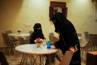 Women sit in the only all-female internet cafe in Marib