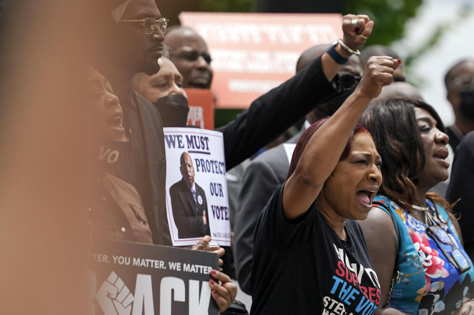 People cheer during prayer at a voting rights rally at Liberty Plaza near the Georgia State Capitol on Tuesday, June 8, 2021, in Atlanta. (AP Photo/Brynn Anderson)