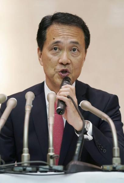 Japanese brokerage Nomura Holdings newly appointed chief executive Kentaro Okuda speaks at a news conference in Tokyo
