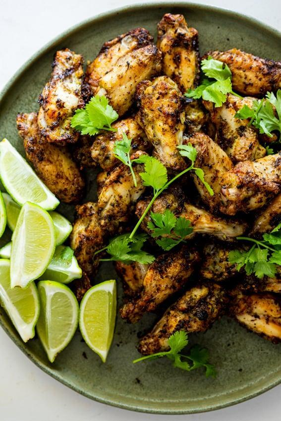 """<p>Made with only seven ingredients, these tasty chicken wings are full of flavor that you won't be able to get enough of. The cilantro-lime marinade makes them come to life, so be sure to make these the next time you want to impress a foodie.</p> <p><strong>Get the recipe</strong>: <a href=""""https://simply-delicious-food.com/cilantro-lime-air-fryer-chicken-wings/"""" class=""""link rapid-noclick-resp"""" rel=""""nofollow noopener"""" target=""""_blank"""" data-ylk=""""slk:cilantro lime air fryer chicken wings"""">cilantro lime air fryer chicken wings</a></p>"""