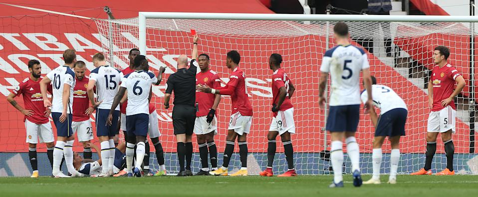 MANCHESTER, ENGLAND - OCTOBER 04: Anthony Martial of Manchester United is sent off during the Premier League match between Manchester United and Tottenham Hotspur at Old Trafford on October 04, 2020 in Manchester, England. Sporting stadiums around the UK remain under strict restrictions due to the Coronavirus Pandemic as Government social distancing laws prohibit fans inside venues resulting in games being played behind closed doors. (Photo by Matthew Peters/Manchester United via Getty Images)