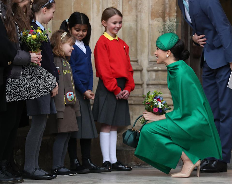 The Duchess of Sussex speaks to school children as she leaves Westminster Abbey, London, following the Commonwealth Service on Commonwealth Day.