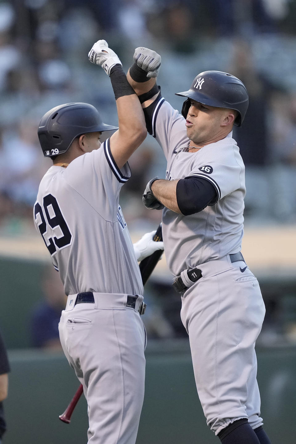 New York Yankees' Brett Gardner, right, celebrates with Gio Urshela after hitting a solo home run against the Oakland Athletics during the second inning of a baseball game Thursday, Aug. 26, 2021, in Oakland, Calif. (AP Photo/Tony Avelar)