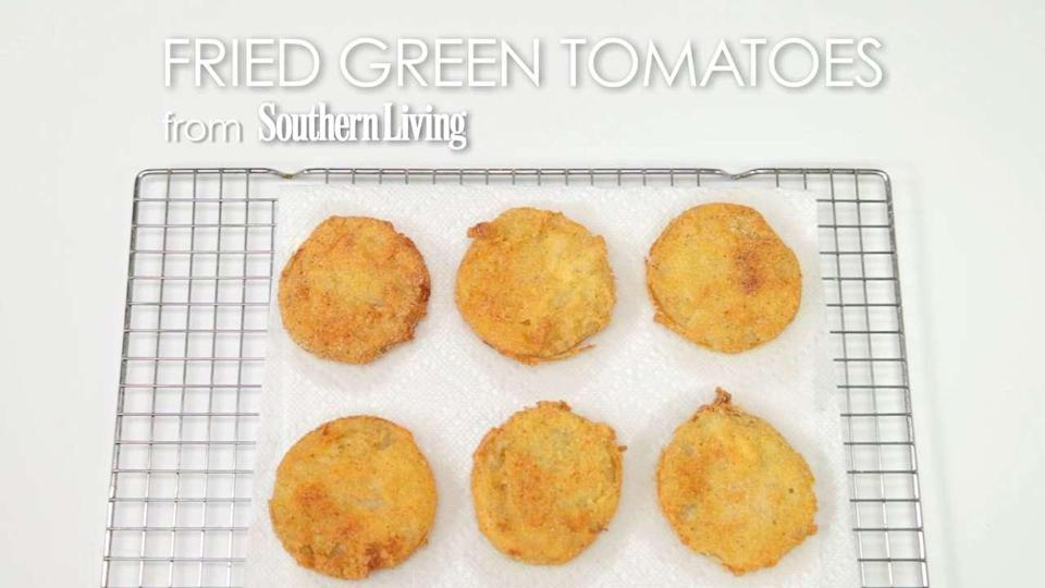 """<p>No one does Fried Green Tomatoes like <em>Southern Living</em>. The cornmeal and flour crust is what sets this recipe apart from others. In only a matter of minutes, your tomatoes will be battered, fried and perfectly crispy. Not only can you enjoy these as a perfect <a href=""""https://www.myrecipes.com/appetizer-recipes"""" rel=""""nofollow noopener"""" target=""""_blank"""" data-ylk=""""slk:summer appetizer"""" class=""""link rapid-noclick-resp"""">summer appetizer</a> paired with <a href=""""https://www.myrecipes.com/recipe/buttermilk-ranch-herb-sauce"""" rel=""""nofollow noopener"""" target=""""_blank"""" data-ylk=""""slk:Buttermilk Herb Ranch Sauce"""" class=""""link rapid-noclick-resp"""">Buttermilk Herb Ranch Sauce</a>, you can also try sandwiching them with lettuce and bacon for an elevated BLT,or scattering them in between fresh tomatoes and mozzarella for crunch and flavor in a <a href=""""https://www.myrecipes.com/course/salad-recipes/easy-green-salads"""" rel=""""nofollow noopener"""" target=""""_blank"""" data-ylk=""""slk:caprese salad"""" class=""""link rapid-noclick-resp"""">caprese salad</a>.</p>"""