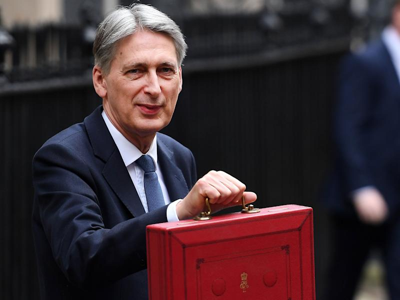 Mr Hammond's announcement of a rise in National Insurance contributions for the self-employed has been criticised by more than a dozen Tory MPs: EPA