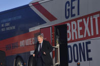 """FILE - In this Monday, Dec. 9, 2019 file photo, Britain's Prime Minister Boris Johnson alights the 'battle bus' as he arrives for a General Election campaign visit to Ferguson's Transport in Washington, England. It's more than four years since Britain voted to leave the European Union, and almost a year since Prime Minister Boris Johnson won an election by vowing to """"get Brexit done."""" Spoiler alert: It is not done. As negotiators from the two sides hunker down for their final weeks of talks on an elusive trade agreement, Britain and the EU still don't know whether they will begin 2021 with an organized partnership or a messy rivalry.(Ben Stansall/Pool Photo via AP, File)"""