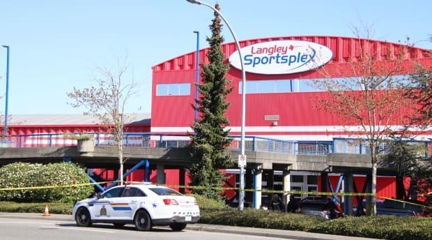 Yellow police tape surrounds the front entrance of the Langley Sportsplex, where a man was fatally shot Wednesday morning.