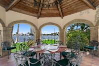 <p>This ornate gazebo is the epitome of sophisticated outdoor dining.</p>