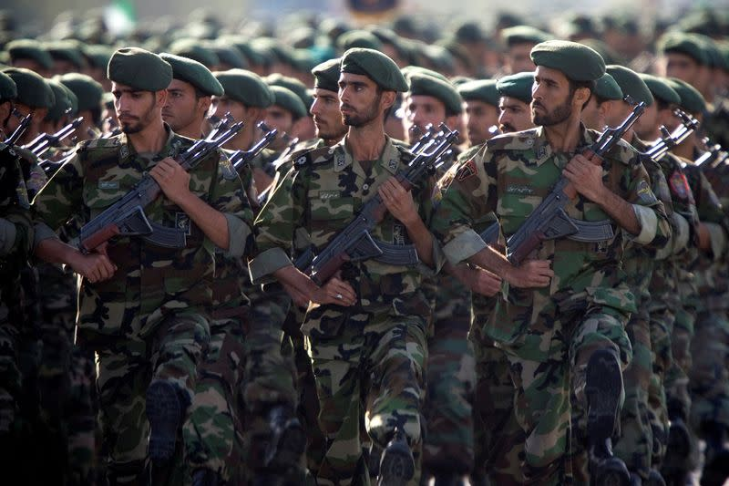 FILE PHOTO: Members of Iran's Revolutionary Guards march during a military parade to commemorate the 1980-88 Iran-Iraq war in Tehran