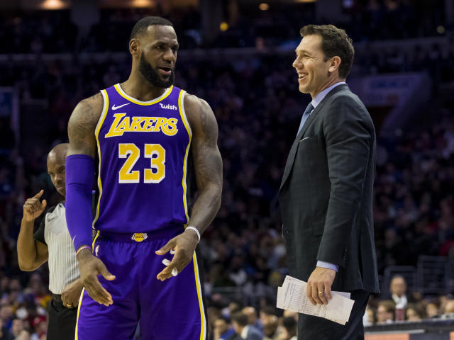 Los Angeles Lakers' head coach Luke Walton, right, talks things over with LeBron James, left, during the first half of an NBA basketball game against the Philadelphia 76ers, Sunday, Feb. 10, 2019, in Philadelphia. The 76ers won 143-120. (AP Photo/Chris Szagola)