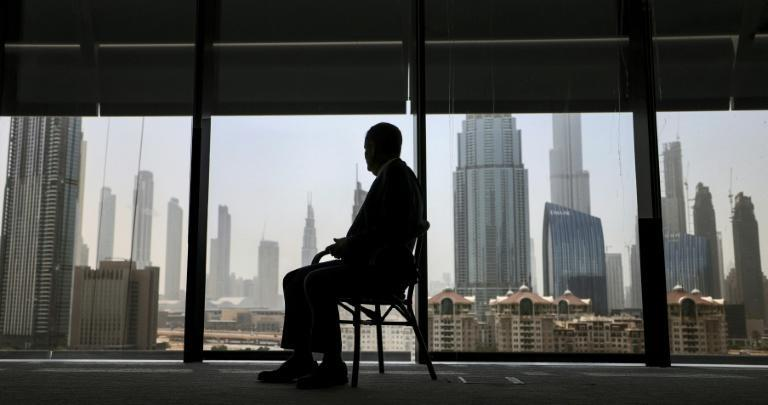 Ilan Sztulman Starosta, head of mission at Israel's consulate in Dubai, sits in his office against the background of the bustling Gulf city state (AFP/Karim SAHIB)