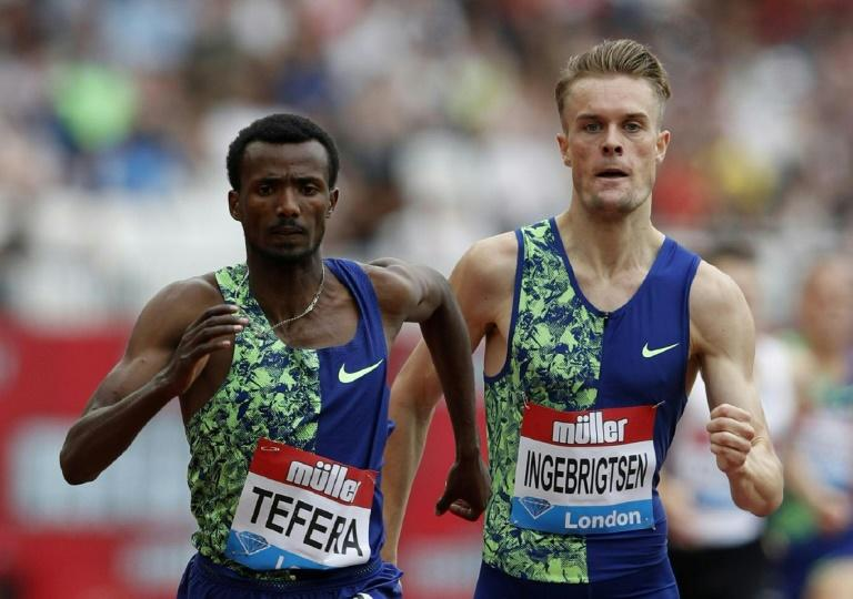 Ethiopia's Samuel Tefera (left) crosses the line ahead of Norway's Filip Ingebrigtsen to win the men's mile at the Anniversary Games in London
