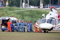 A body believed to be 15-year-old Irish girl Nora Anne Quoirin who went missing is brought out of a helicopter in Seremban.
