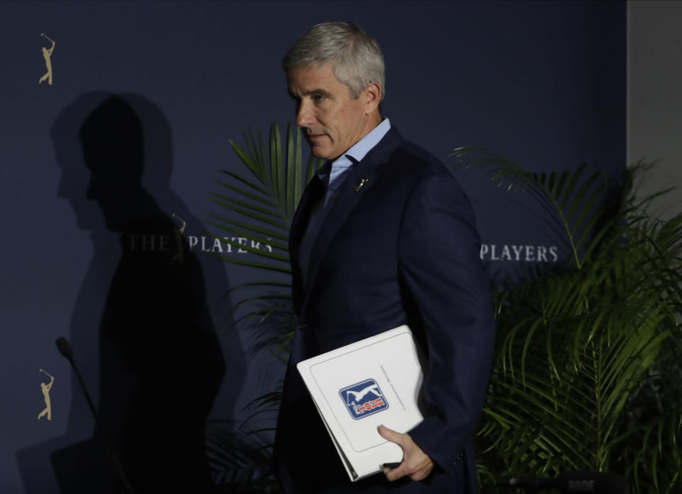 FILE- In this March 13, 2020 file photo, PGA Tour Commission Jay Monahan attends a news conference in Ponte Vedra Beach, Fla. This week marks a year since Monahan announced the tour would shut down because of the COVID-19 pandemic. (AP Photo/Chris O'Meara, File)
