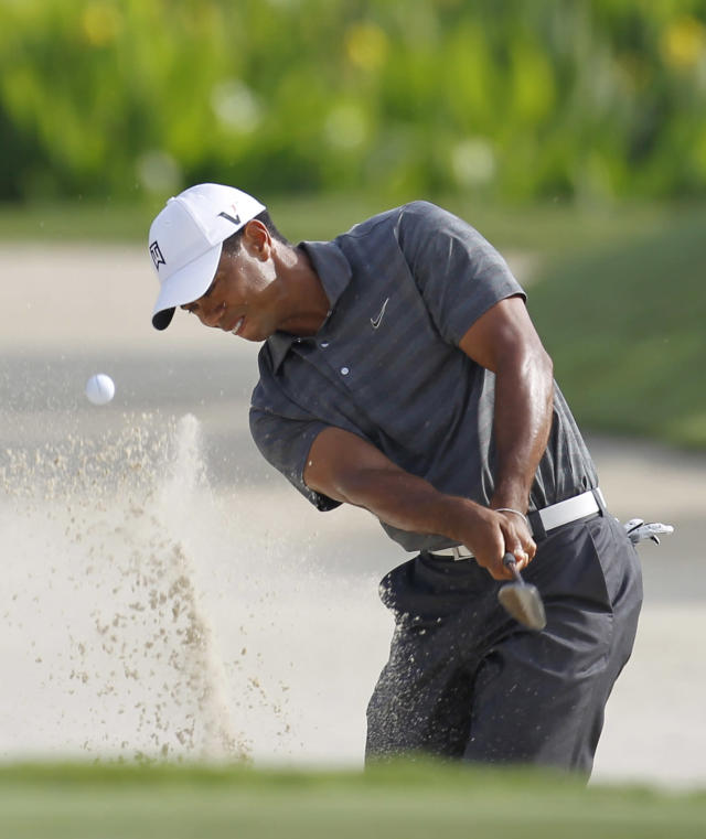Tiger Woods hits from an 11th hole bunker during the first round of the Players Championship golf tournament, Thursday, May 10, 2012, at Sawgrass in Ponte Vedra, Fla. (AP Photo/Chris O'Meara)