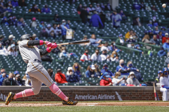 Pittsburgh Pirates' Wilmer Difo hits a two-run single off Chicago Cubs starting pitcher Kyle Hendricks during the first inning of a baseball game, Sunday, May 9, 2021, in Chicago. (AP Photo/Kamil Krzaczynski)