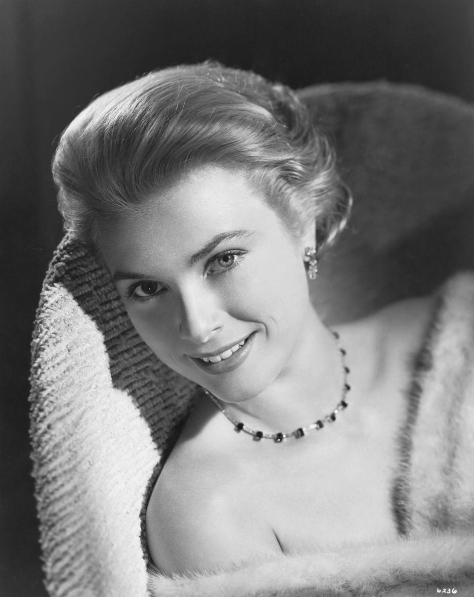 Actress turned Princess, Grace Kelly, smiles in this closeup photo.