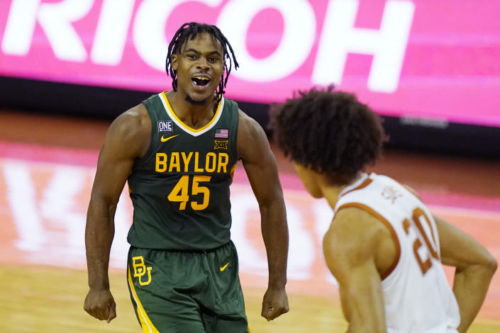 Baylor guard Davion Mitchell (45) celebrates a score against Texas during the second half of an NCAA college basketball game Tuesday, Feb. 2, 2021, in Austin, Texas. (AP Photo/Eric Gay)