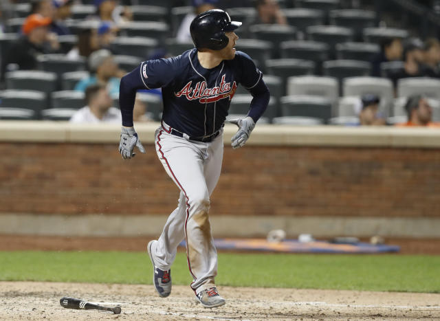 Atlanta Braves' Freddie Freeman watches his two-run double during the seventh inning of a baseball game against the New York Mets, Sunday, June 30, 2019, in New York. (AP Photo/Kathy Willens)