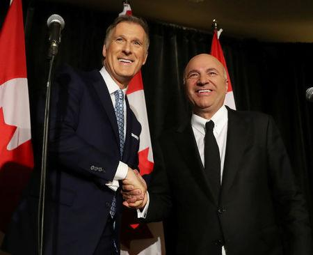 Conservative Party of Canada's leadership candidates Kevin O'Leary and Maxime Bernier shake hands at a news conference in Toronto, Canada April 26, 2017. O'Leary announced his withdrawal from the race and his support for Bernier.  REUTERS/Fred Thornhill