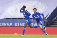 Leicester's Wilfred Ndidi, left, celebrates after scoring his team's opening goal during the English Premier League soccer match between Leicester City and Chelsea at the King Power Stadium in Leicester, England, Tuesday, Jan. 19, 2021. (Michael Regan/Pool via AP)