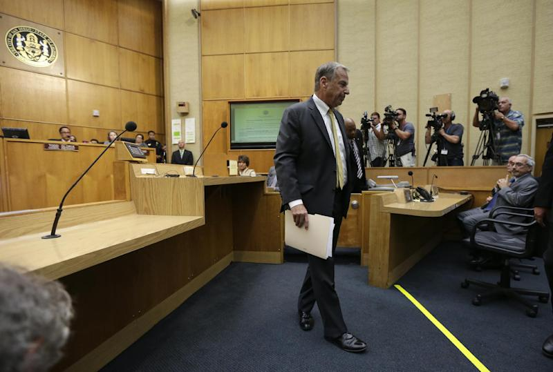 San Diego Mayor Bob Filner walks away after agreeing to resign at a city council meeting Friday, Aug. 23, 2013, in San Diego. The San Diego city council voted Friday on the agreement between Filner and city negotiators that lead to his resignation following allegations of sexual harassment. (AP Photo/Gregory Bull)