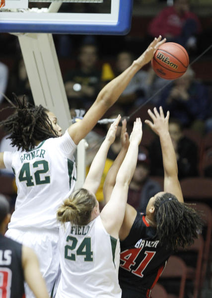 Baylor center Ashley Field (24) defends Texas Tech forward Kelsi Baker (41) as Baylor center Brittney Griner (42) blocks her shot during the first half of a second round NCAA college basketball game at the women's Big 12 Conference tournament, Thursday, March 8, 2012 in Kansas City, Mo. (AP Photo/Jeff Tuttle)
